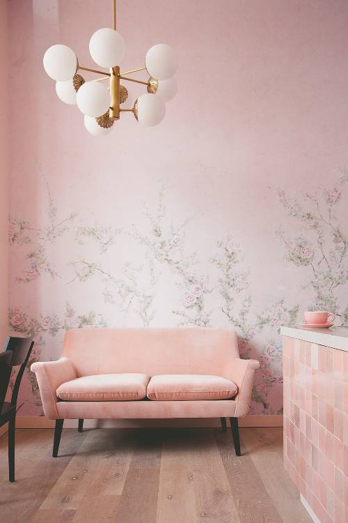 soft pink interior design soft pink wall painting with light gray floral pattern soft pink sofa in midcentury modern style wood floors