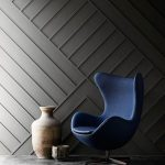 Textured Molding Pattern Wall Idea In Matte Black Deep Blue Chair In Modern Style Decorative Vase