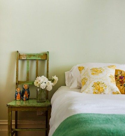 vintage bedroom design old look chair as the bedside table white bedding with yellow flower pattern pillows
