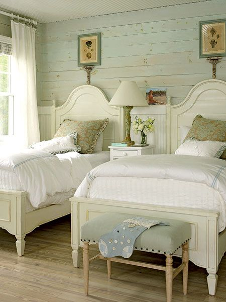 white crisp cottage bedroom wood board walls twin cottage bed frames with headboard in white white window curtains