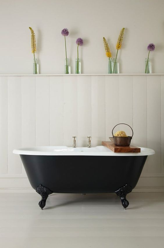 white dove bathroom design with half way vertical wood board walls bathtub in black white dove floors some glass vases with vivid flowers