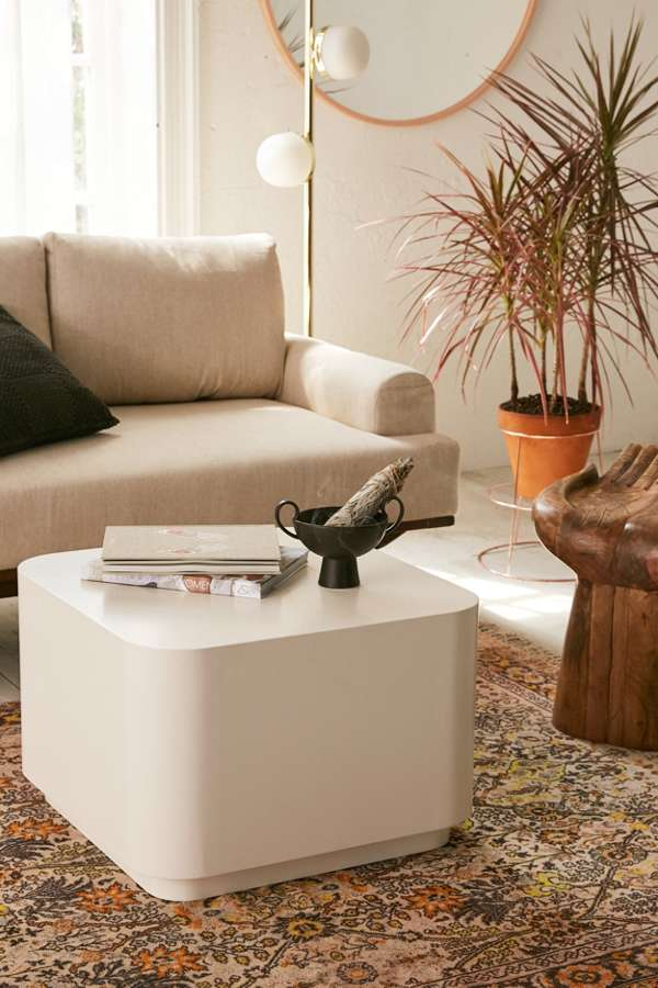 white minimalist coffee table in square shape without any sharp edges