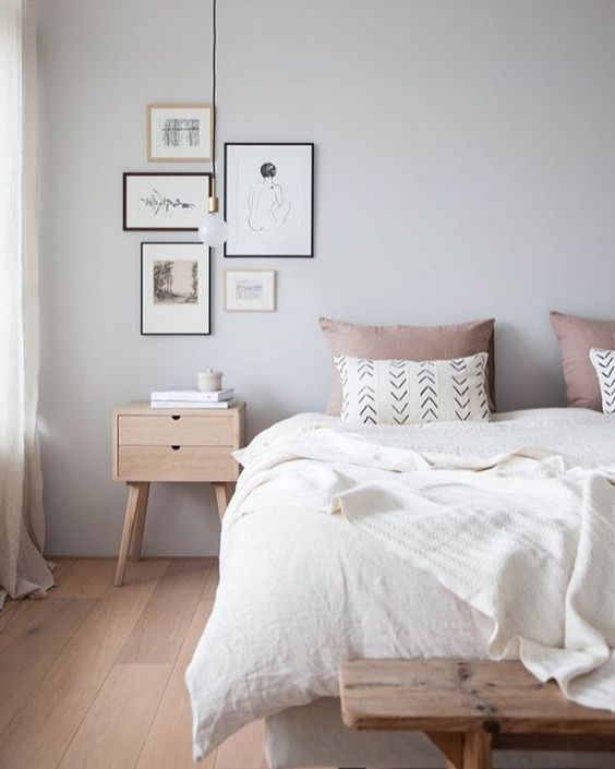 white wall painting light wood bedside table light wood bed bench white bed cover set white pillowcase with modern patterns light milo pillowcases long cable pendant framed pictures