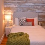 Whitewashed Wood Pallete Wall Warm Feel Light Effect From Table Lamp Bed Frame With Headboard White Bedding Green Throw Blanket
