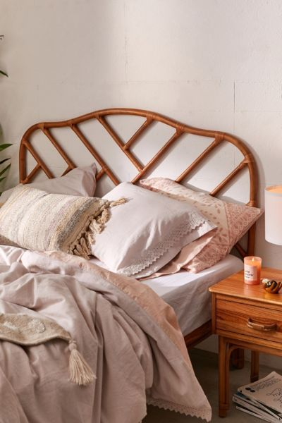 winter themed bedroom with boho touch bowel bed frame with rattan tied headboard dusty white bedding treatment wooden side table