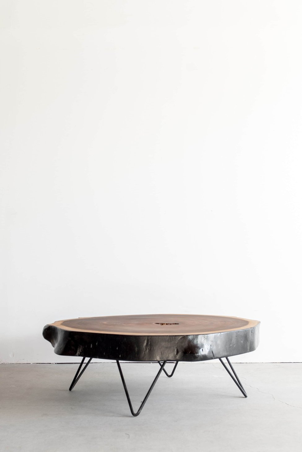 wooden coffee table with lower hairpin legs and smooth surface