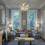 Conventry Gray Wall Paint By Benjamin Moore Gray Couch Blue Patterned Chairs Gray Area Rug Charming Chandelier