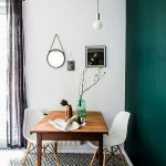 Scandinavian Style Dining Room Midcentury Modern Wood Dining Table Midcentury Modern Dining Chairs Black White Tile Floors Deep Green Wall Accent
