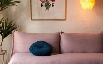 cushioned sofa in soft pink deep blue couch pillow in round shape antique moroccan area rug wood coffee table in small size