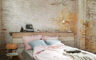 industrial bedroom idea brick walls bed frame with pallet headboard gray bed linen small chair black wrought iron framed windows