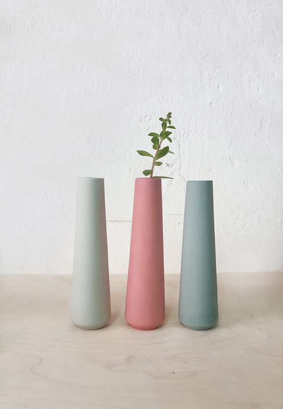 ornate ceramic vases in soft colors