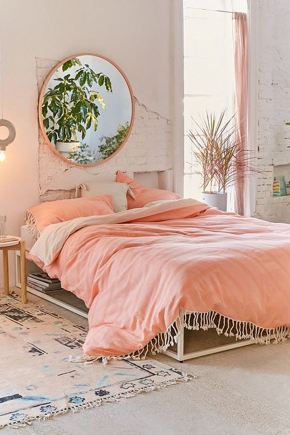 shabby chic bedroom in pastel and white giant wall mirror in round shape pastel comforter and pillowcase whitewashed walls
