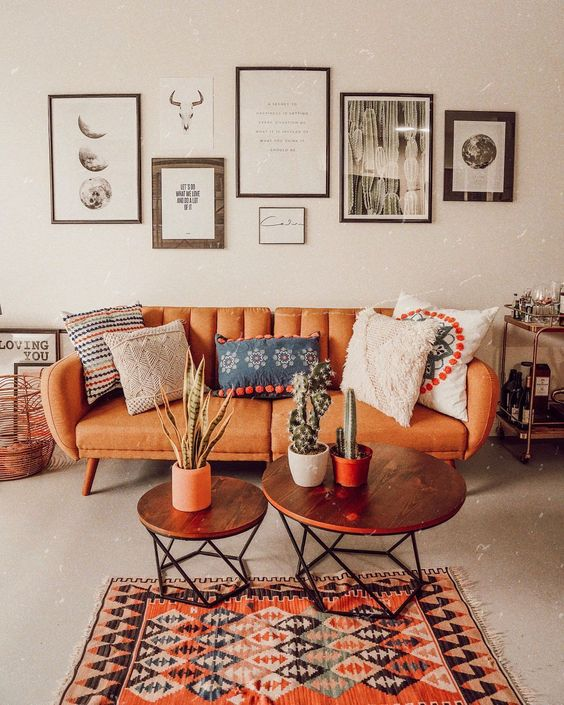 simple living room midcentury modern couch with leather finishing two coffee table with round wood top ethnic area rug
