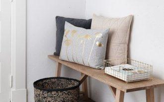 tiny hallway idea light wood bench seat ornate basket stucco floors modern pendant