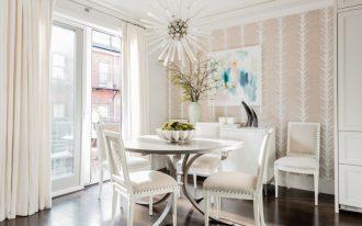 transitional dining room traditional dining chairs in white traditional dining table in white light wallpaper light cream draperies dark wood floors