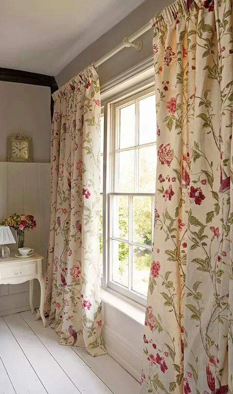 vintage curtains with mauve flower motifs