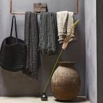 Wabi Sabi Interior Idea Gray Wall Painting Idea Brass Hanger For Storage Solution Ornate Vase Concrete Floors