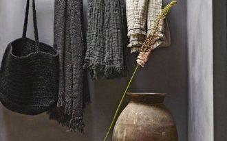wabi sabi interior idea gray wall painting idea brass hanger for storage solution ornate vase concrete floors