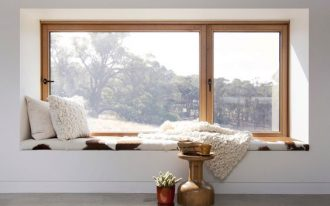 window seat as smaller belvederes supported with wood frame and clear glass panels some throw pillow throw blanket sheepskin