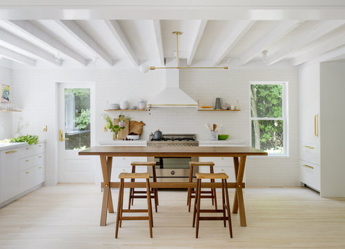Scandinavian kitchen wood dining furniture set open shelving unit white kitchen cabinetry exposed beams in white light wood floors