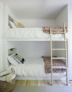 Scandinavian loft bed frame with light wood ladder