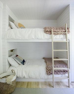 Scandinavian loft bed frame with light wood ladder