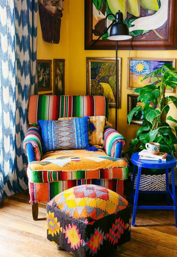 colorful striped corner chair patterned & colorful table deep blue side table yellow wall painting colorful and patterned drapery