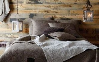 contemporary rustic bedroom idea reclaimed wood wall industrial lighting fixtures gray bedding treatment