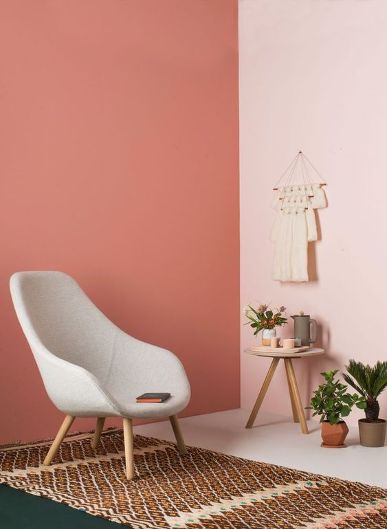 gap color solid pink light pink on wall midcentury modern chair in white with angled wood legs patterned runner round top wood table with angled legs potted greenery in small size