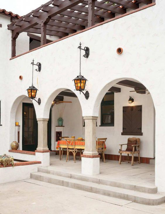 long exterior corridor with furniture set curved doors white stuco exterior walls
