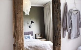 oversized mirror in rustic style with heavy and aged frame