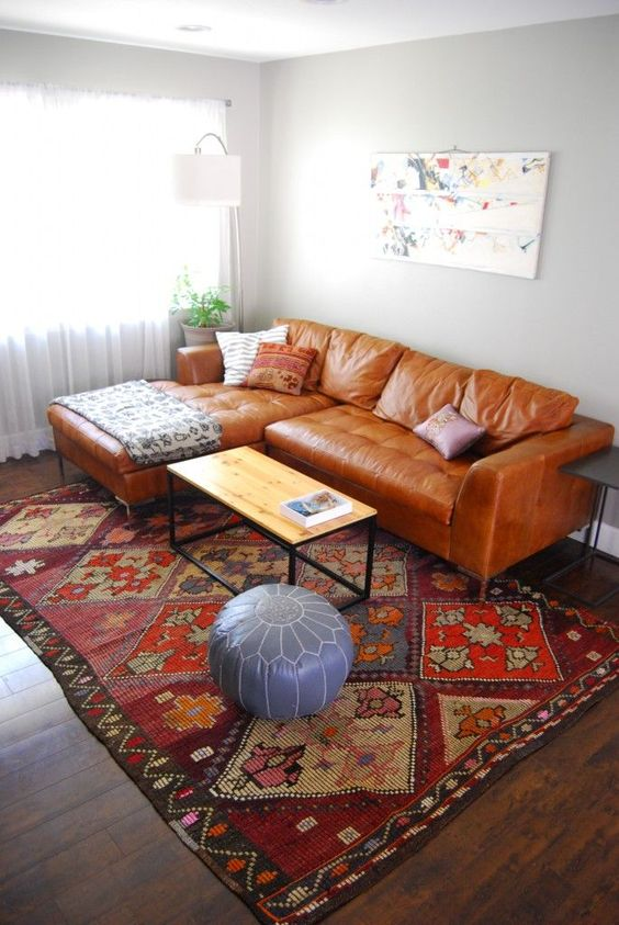 persian rug leather couch with facing chaise wood top coffee table with black iron legs ottoman chair