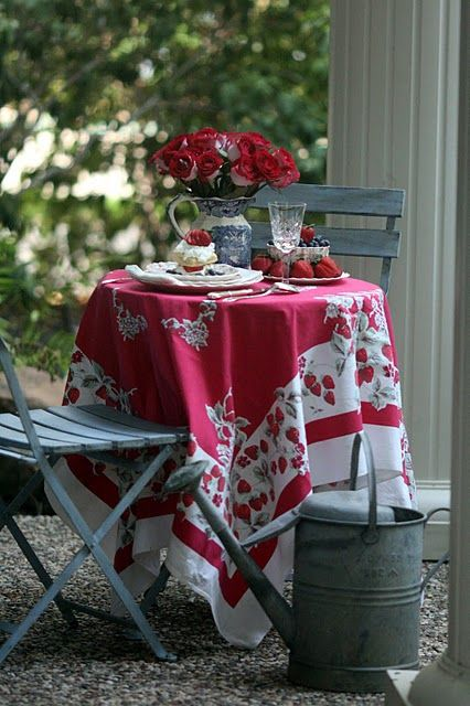 poppy colored table cover in French country seating area