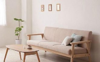 raw wood furniture set consisting of wood structured sofa with warm & light tone upholstery and coffee table