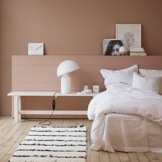 ultramodern bedroom white comfy bedding treatment in white long bench bedside table in white light pink wall painted striped modern runner in white black wood planked floors