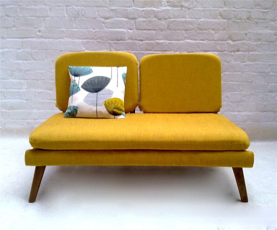 ultramodern couch in mustard with throw pillow