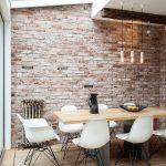 Urban Industrial Dining Room Exposed Brick Wall Midcentury Modern Dining Furniture Set Industrial Style Pendants Medium Sized Skylight Lightwood Floors