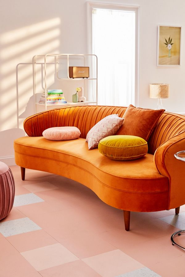Camila velvet sofa in terracotta throw pillows pink area rug