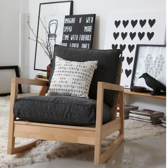 Ikea's rock chair with thicker cushions in black and a throw pillow