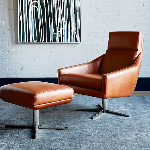 West Elm's leather armchair with stainless steel base leather ottoman with steel base