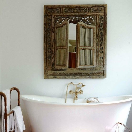 artistic window with handmade carvings from Indonesia white bathtub