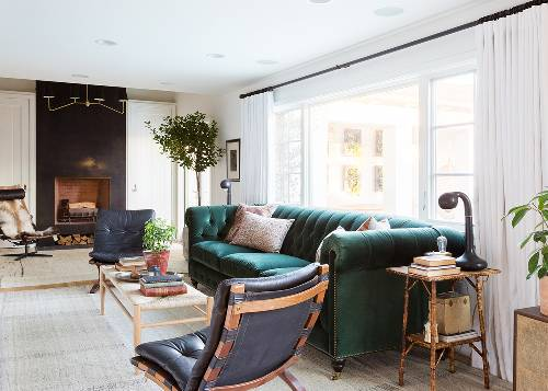black leather reclining chairs dark green velvet sofa with tufted upholstery light wood coffee table