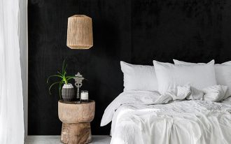 bold black hand painted walls whitewashed floors all white bedding treat hardwood bedside table