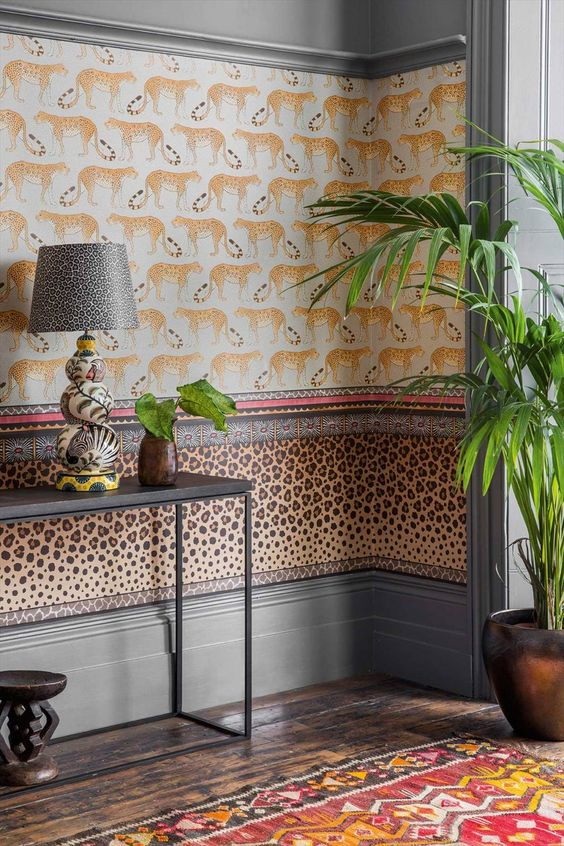 bordered wallpaper with animal character simple lounge console table in black metal potted plant wood floors