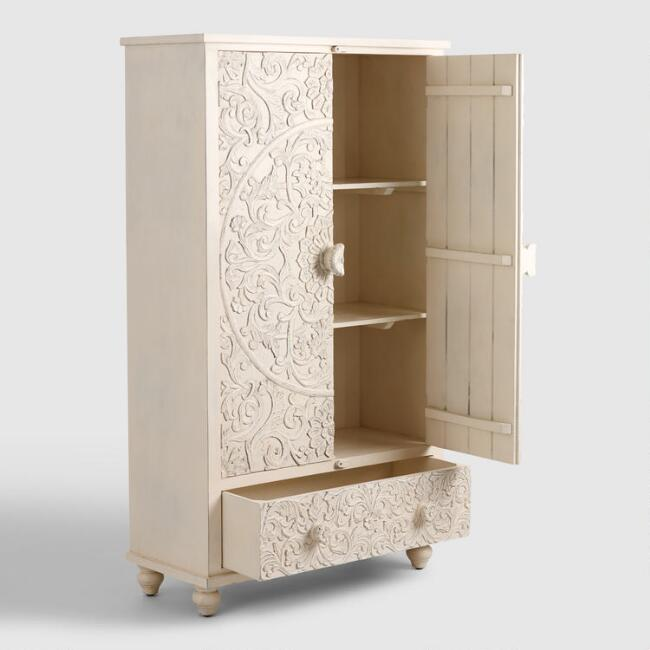 bright tone armoire with floral carvings on both side of door panels
