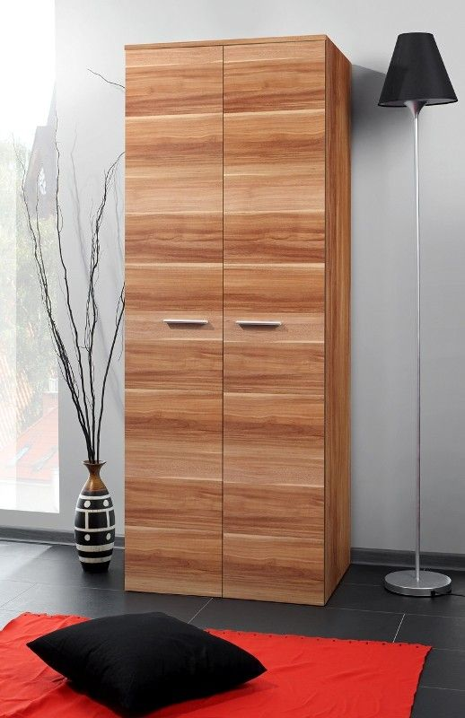 clean lines and minimalist wood armoire with brass handles high floor lamp with black lampshade red carpet black floor pillow