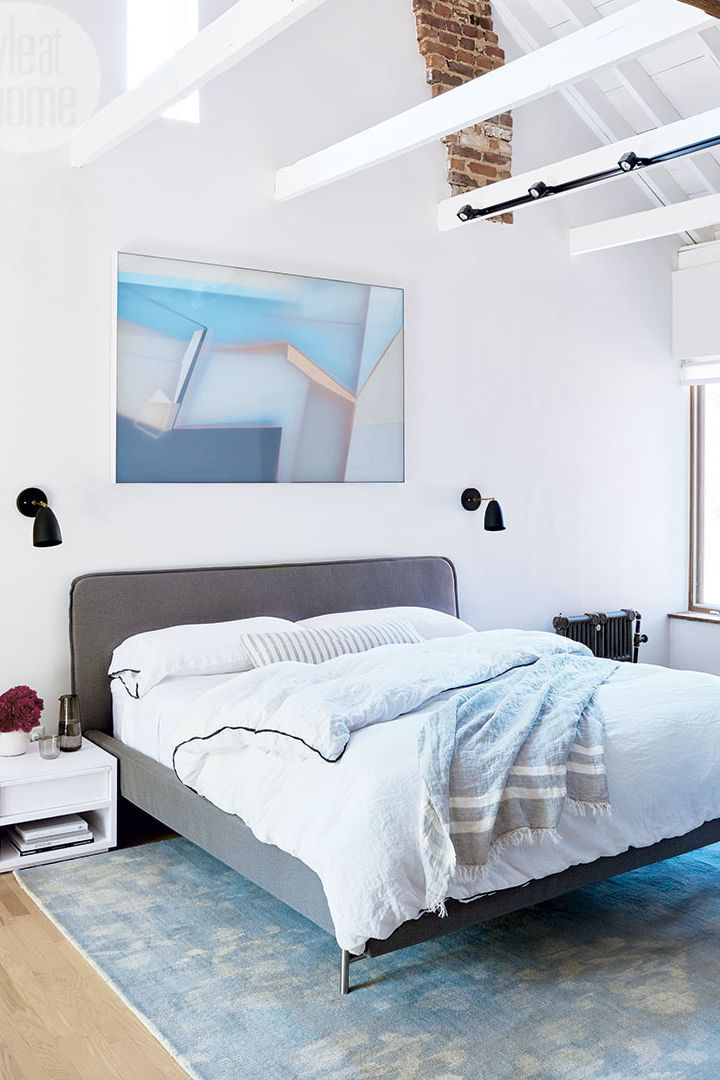 contemporary bedroom idea exposed beams in white white crips wall painting modern wall art modern bed with headboard in gray sea blue rug white bedside table in white