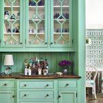 Cool Green Buffet With Glass Door And Dark Countertop