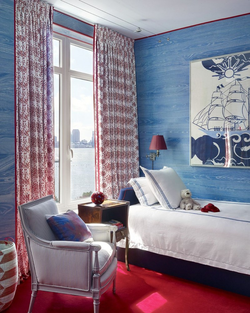 corn flower blue hand painted walls bright red area rug bold patterned draperies striped chair white bed linen