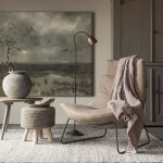 Deep Seat Leather Chair With Metal Structure Tiny Side Table Knitted Area Rug